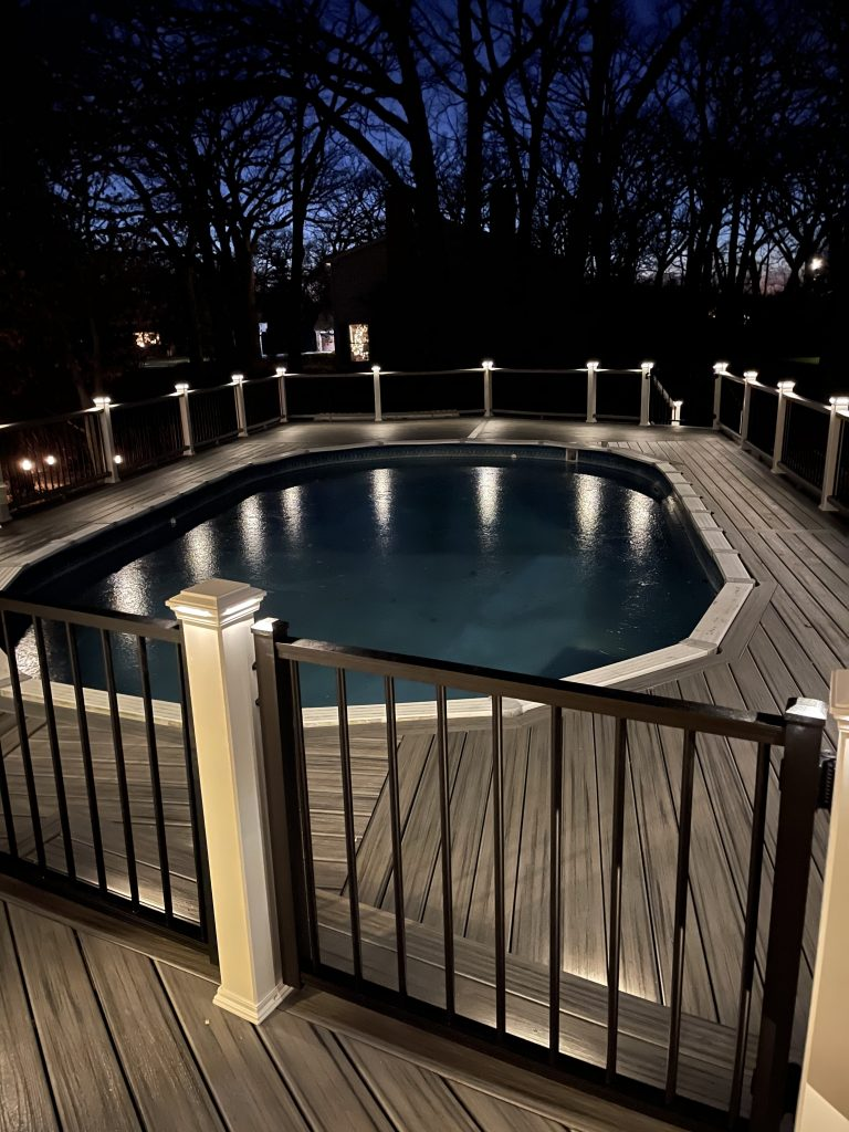 Pool deck gate and lighting